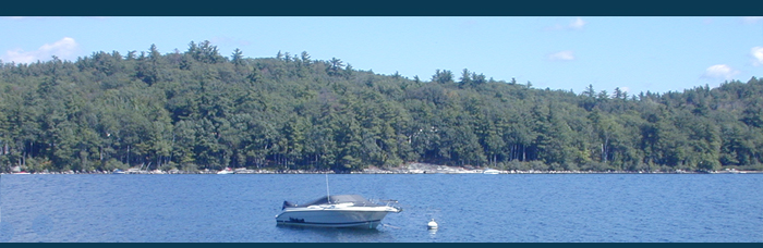 Masthead photo of boat on beautiful Maine lake